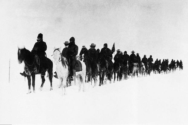 Soldiers returning from the battle of Wounded Knee. (National Archives)