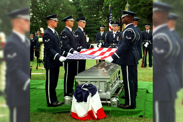 Members of the Air Force Honor Guard prepare to fold the flag during funeral services honoring U.S. Air Force 1st Lt. Michael Blassie on July 11, 1998, at Jefferson Barracks National Cemetery, south of St. Louis, Mo. (Photo: U.S. Air Force)