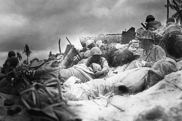 Marines take cover during the Battle of Tarawa, November 1943. (U.S. Navy photo)