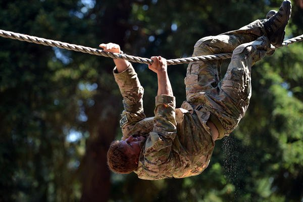 1st Lt. Matthew Rother on a rope obstacle.
