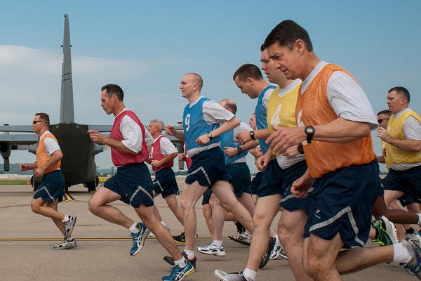 Members of the 123rd Airlift Wing conduct a mass physical fitness test