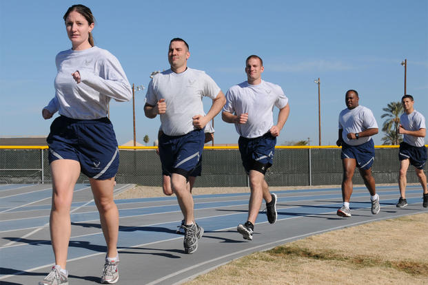 944th Fighter Wing members run laps at the base track. (Air Force photo)