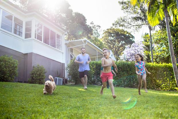 Family playing in yard