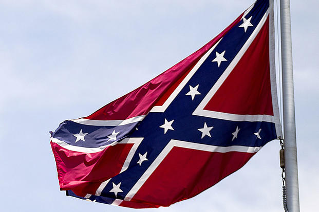 In this June 30, 2015, file photo, a Confederate flag flies at the base of Stone Mountain in Stone Mountain, Georgia. David Goldman/AP