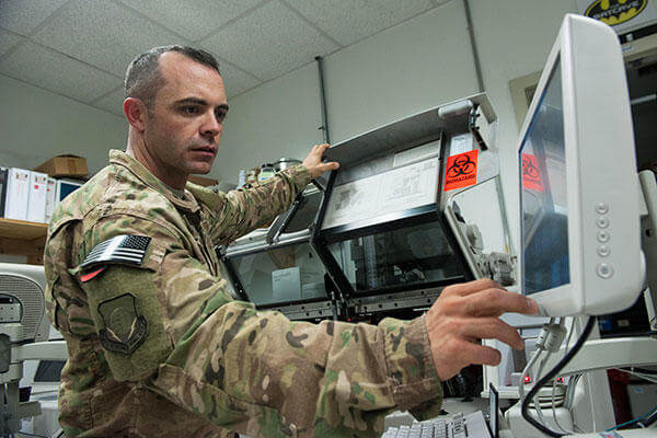 Tech. Sgt. Scott Hatch performs maintenance on a blood testing machine at Bagram Airfield, Afghanistan, Sept. 24, 2015. (U.S. Air Force /Tech. Sgt. Joseph Swafford)