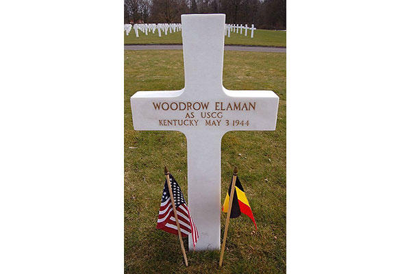 The grave of Woodrow Elaman, USCG, at the Ardennes American Cemetery in Neupre, Belgium, who was killed in action during World War II. Members of Coast Guard Activities Europe have adopted his grave. (American Battle Monuments Commission photo)