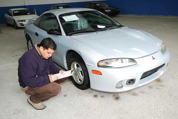 An Incirlik Delta Shipping Vehicle Inspector Inspects A Car Prior To  Shipment. Master Sgt.