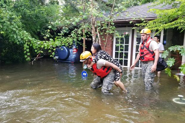 Texas National Guardsmen aid citizens in heavily flooded areas of Houston after Hurricane Harvey. Lt. Zachary West/Army