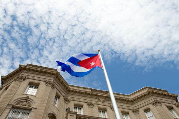 The Cuban flag is raised over their new embassy in Washington, Monday, July 20, 2015. (AP Photo/Andrew Harnik, Pool)