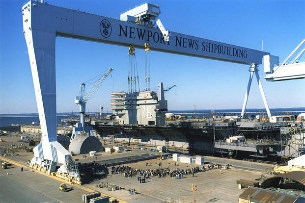 The island structure of the aircraft carrier Ronald Reagan (CVN 76) is lifted into place at Newport News Shipbuilding. (Photo: U.S. Navy, courtesy of Newport News Shipbuilding.)