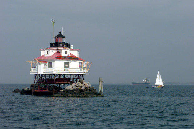 A sailboat cruises by Thomas Point Light in the Chesapeake Bay. USCG photo by PA1 Pete Milnes.