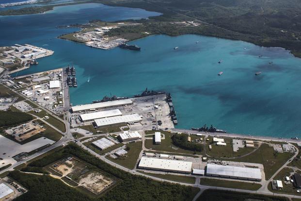 An aerial view from above U.S. Naval Base Guam (NBG) shows Apra Harbor. (U.S. Navy/ Jeffrey Landis)