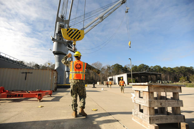 Sailors from Navy Cargo Handling Battalion ONE (NCHB 1) practice using a crane at a training simulator at Naval Weapon Station Yorktown, Jan. 6, 2016. (U.S. Navy Photo/Mass Communication Specialist 2nd Class Benjamin Wooddy)