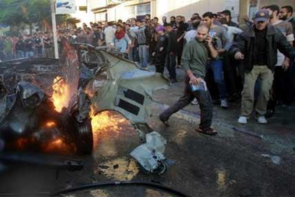 People look at a wreckage of the car in which was killed Ahmed Jabari, head of the Hamas military wing in Gaza City, Wednesday, Nov. 14, 2012.