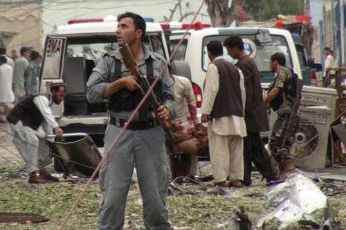 Security officials conduct investigation at the scene of suicide bomb attacks at the Indian Consulate in Jalalabad, Afghanistan, Saturday, 3, 2013. (AP Photo/Babrak)
