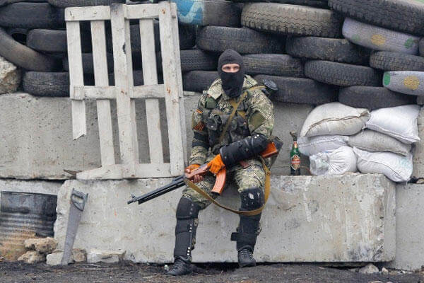 A pro-Russian militant guards barricades near Slovyansk, eastern Ukraine, on Wednesday, April 30, 2014. (Sergei Grits/AP)