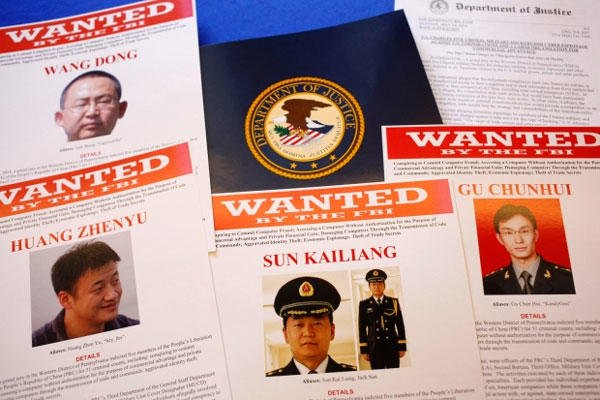 Press materials are displayed on a table of the Justice Department in Washington, Monday, May 19, 2014, before Attorney General Eric Holder was to speak at a news conference. (Charles Dharapak/AP)