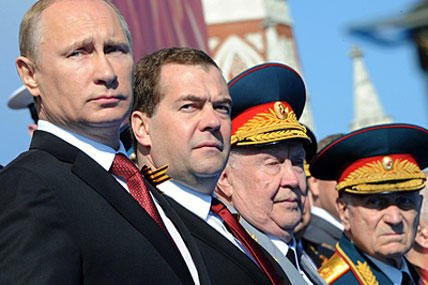 President Vladimir Putin and officials observe as Russia shows off its military might in its annual Red Square parade marking victory over Nazi Germany.