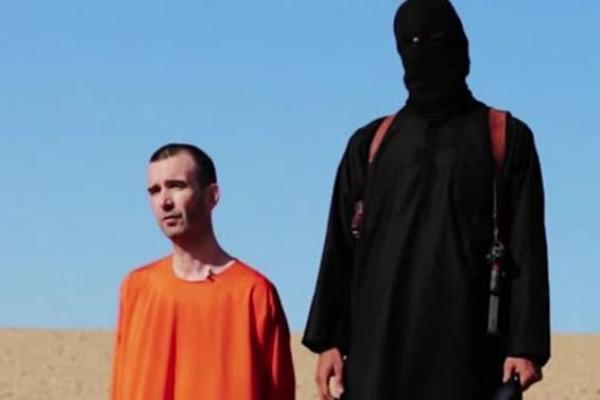 Islamic State extremists have released a video showing the beheading of British aid worker David Haines, who was abducted in Syria last year. (Associated Press)