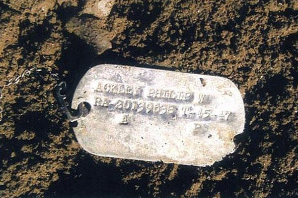 This undated file photo shows Pfc. Philip W. Ackley's Korean War dog tag. The tag was found in North Korea's Unsan battlefield area where Ackley is believed to have been lost. DoD file photo/AP