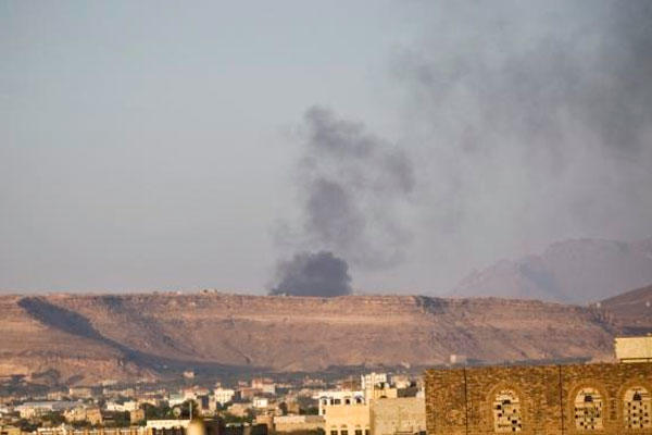 Smoke rises from an area due to Saudi-led airstrikes in Sanaa, Yemen, Monday, March 30, 2015. (AP Photo/Hani Mohammed)