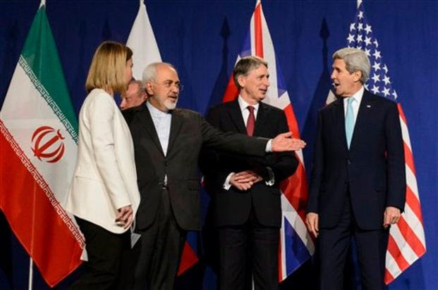 Federica Mogherini, Mohammad Javad Zarif, Philip Hammond, and John Kerry line up for a press announcement after the end of a new round of Nuclear Iran Talks in Lausanne, Switzerland, Thursday, April 2, 2015. (AP Photo/Keystone, Jean-Christophe Bott)