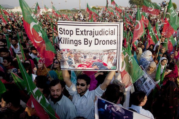 In this Friday, Oct 28, 2011, file photo, supporters of Pakistani cricketer-turned-politician Imran Khan rally to condemn U. S. drone attacks in Pakistani tribal areas on al-Qaida and Taliban hideouts, in Islamabad, Pakistan. B.K. Bangash/AP