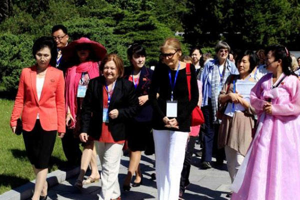 Activist Gloria Steinem and other delegates visit Mangyongdae, the birthplace of North Korea's late leader Kim Il Sung, in Pyongyang, Wednesday, May 20, 2015. (AP Photo/Kim Kwang Hyon)