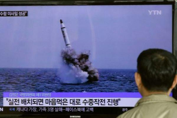 A South Korean man watches a TV news program showing an image of North Korea's ballistic missile believed to have been launched from underwater in South Korea on May 9, 2015. (Photo: Ahn Young-joon/AP)