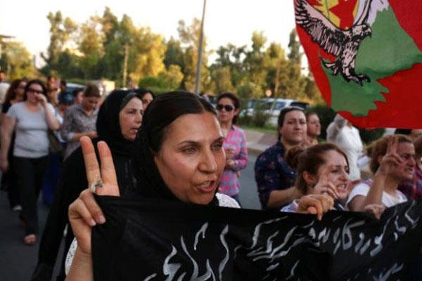 In this Saturday, July 25, 2015 photo, supports of the Kurdistan Workers' Party, or PKK, march during a demonstration in Irbil, in the Northern Kurdish region of Iraq. (AP Photo/Bram Janssen)
