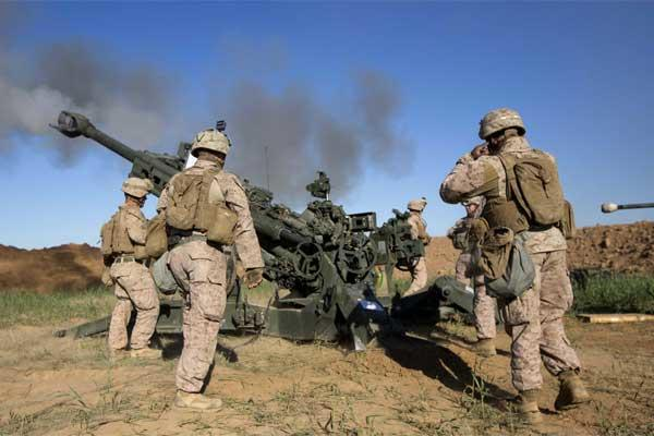 U.S. Marines with Task Force Spartan, 26th Marine Expeditionary Unit (MEU), on Fire Base Bell, Iraq, fire an M777A2 Howitzer at an ISIS infiltration route March 18, 2016.  (Photo By: Cpl. Andre Dakis)