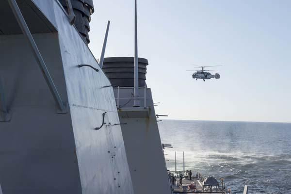 A Russian Kamov KA-27 Helix closely surveils the guided missile destroyer USS Donald Cook (DDG 75) while the ship was operating in international waters April 12, 2016. (U.S. Navy 6th Fleet photo/Released)