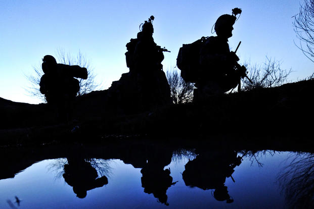 U.S. Army soldiers rest next to a canal while conducting a patrol during Operation Helmand Spider in Badula Qulp in Helmand province, Afghanistan, Feb. 15, 2010. Tech. Sgt. Efren Lopez/Air Force