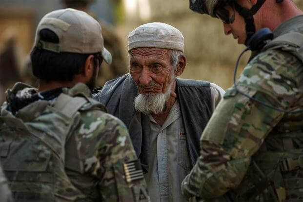 Alex Unguist, left, interpreter, and U.S. Air Force Master Sgt. Richard Holder, right, talk with the village elder Oct. 25, 2012, outside Bagram Airfield, Afghanistan. (USAF photo/Staff Sgt. Jonathan.