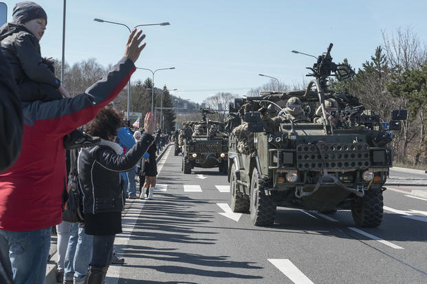 Citizens greet Battle Group Poland as a tactical vehicle convoy crosses into Poland March 26, 2017. U.S. Army 2nd Squadron, 2nd Cavalry Regiment, and other nations are deployed as part of NATO's Enhanced Forward Presence. Sgt. 1st Class Patricia Deal/Army