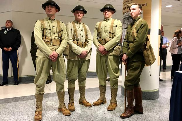 "Dressed in WWI uniforms, members of the 3rd U.S. Infantry Regiment, ""The Old Guard,"" stand next to historian Todd Rambow at the Pentagon following a ceremony to commemorate the 100th anniversary of the U.S. miliary entering WWI.(Matt Cox/Military.com)"