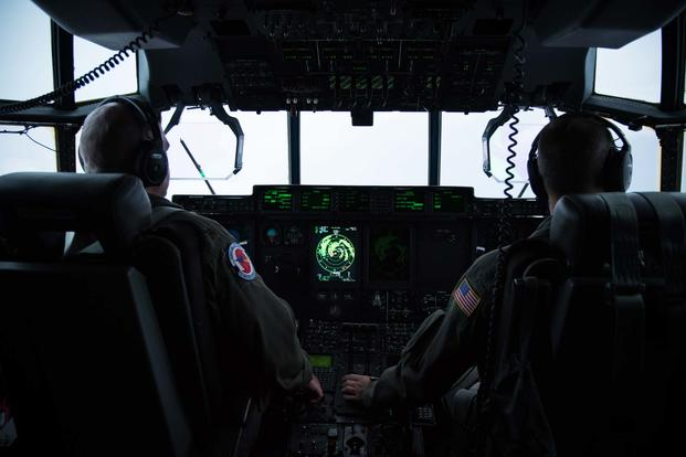 Maj. Kendall Dunn and Lt. Col. Ivan Deroche fly a WC-130J Super Hercules aircraft into Hurricane Harvey during a mission out of Keesler Air Force Base, Mississippi Aug. 24, 2017. (U.S. Air Force/Staff Sgt. Heather Heiney)