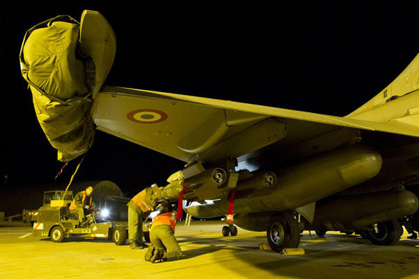 French soldiers prepare a Rafale fighter from the Saint Dizier airbase, eastern France. French fighter jets bombed rebel targets in a major city in Mali's north on Jan. 13, 2013.(AP Photo/Laure-Anne Maucorps, ECPAD)