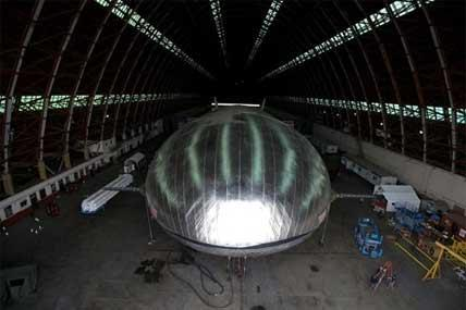 In this Jan. 24, 2013, file photo, the Aeroscraft airship, a high-tech prototype airship, is seen inside a World War II-era hangar in Tustin, Calif.
