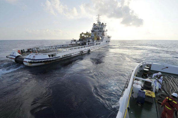 China's rescue ships sail different ways as they conduct a search operation for a missing Malaysia Airlines Boeing 777, flight MH370. (AP Photo/Xinhua, Zhao Yingquan)