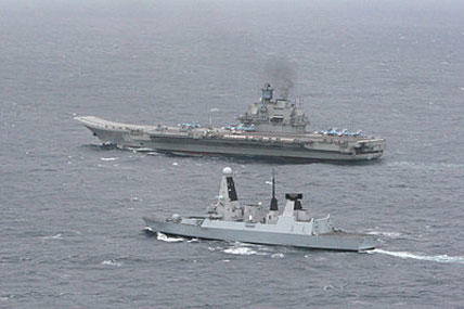 Britain's HMS Dragon, a Type 45 destroyer, monitored the movement of the seven-strong Russian group Thursday led by the aircraft carrier Admiral Kuznetsov.