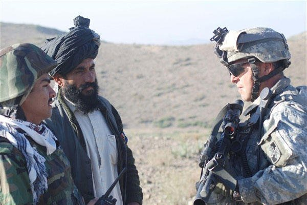 Army 1st Lt. Robin C. Crumpler from Beulaville, N.C., questions an Afghan man  through an interpreter during a security patrol in Khowst province, Afghanistan. (Photo by Staff Sgt. Luis P. Valdespino Jr., USMC)
