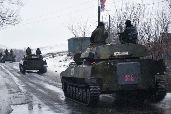 A pro-Russian armored vehicle moves toward Slovyanoserbsk, eastern Ukraine, Wednesday, Jan. 21, 2015. (AP Photo/Mstyslav Chernov)