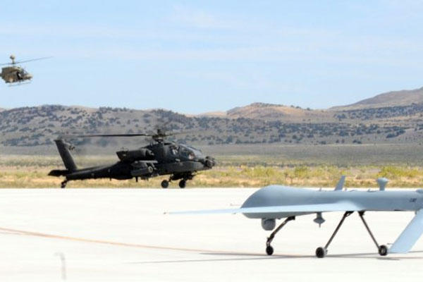 An AH-64D Apache Longbow and MQ-1C Gray Eagle helicopter land at Michael Army Airfield, Utah, Sept. 16, 2011, after the completion of the Manned Unmanned Systems Integration.  (U.S. Army photo)