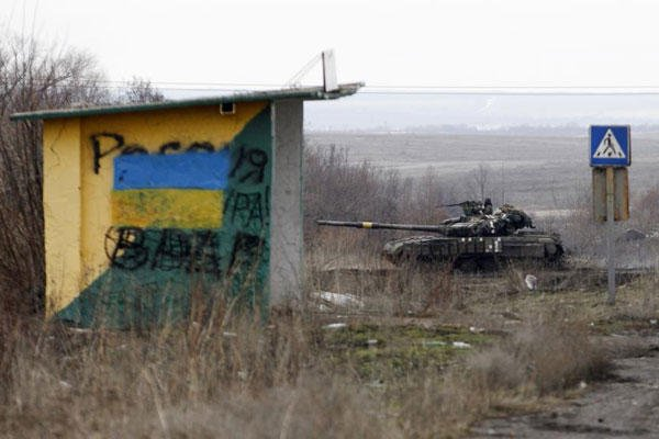 A Ukrainian army vehicle drives through fields near the town of Debaltseve, Ukraine, Monday, Feb. 2, 2015. (AP Photo/Petr David Josek)