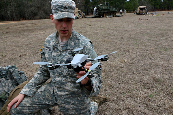 Soldiers with the U.S. Army's Experimentation Force, known as EXFOR, test miniature drones during an exercise March 4 at Fort Benning, Georgia. Photo by Matthew Cox/Military.com