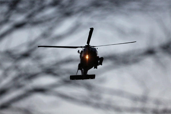 The helicopter from the Elizabeth City Coast Guard Air Station carrying Louis Jordan arrives at Sentara Norfolk General Hospitalin Norfolk, Va., on Thursday, April 2, 2015. (AP Photo/The Virginian-Pilot, Steve Earley)
