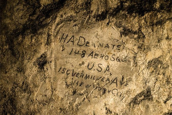 In this image made on Feb. 20, 2015 showing a name engraved on the walls of a former chalk quarry, at the Cite Souterraine, Underground City, in Naours, northern France by HA Deanate, 148th Aero Squadron, USA. (AP Photo/Jeffrey Gusky)