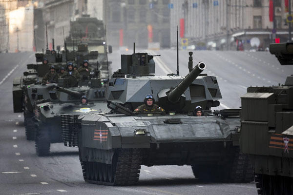 Russian military vehicles including the new Russian T-14 Armata tank, center, make their way to Red Square during a rehearsal for the Victory Day military parade in Moscow, Russia, Monday, May 4, 2015.(AP Photo/Alexander Zemlianichenko)