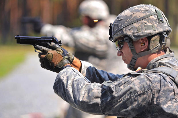 U.S. Army soldiers fire M9 pistols. Army weapons officials want to replace the M9 with the Modular Handgun System. (US Army)